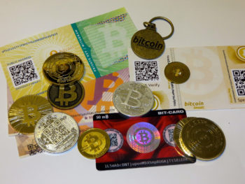 paper and coins of bitcoin