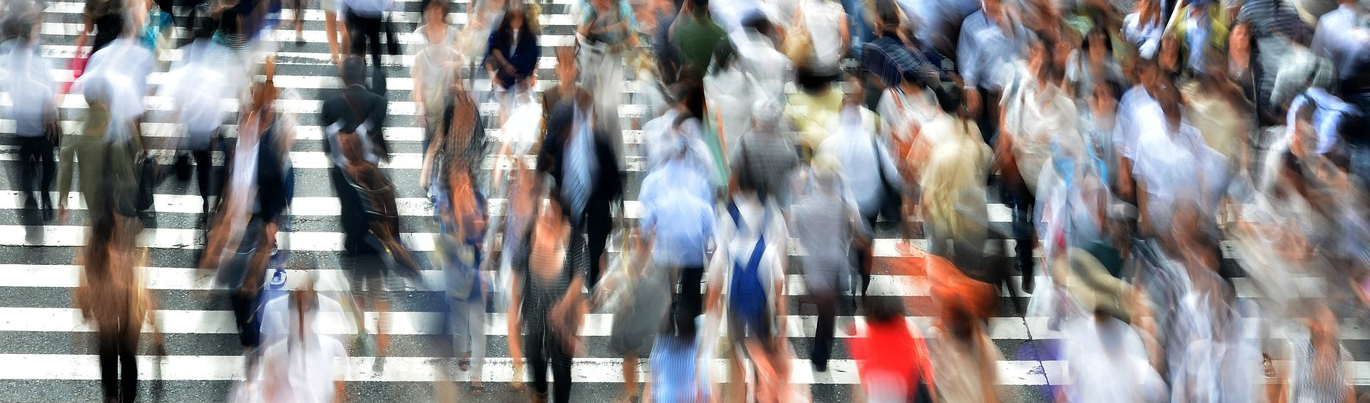 pedestrians crossing an urban street