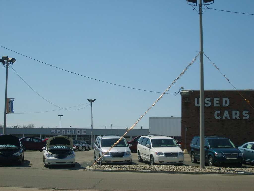 several cars in a used car lot