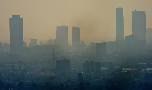 Cityscape filled with smog.