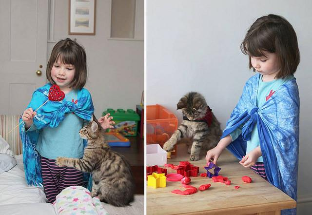 a young girl plays with Play Dough and her pet cat