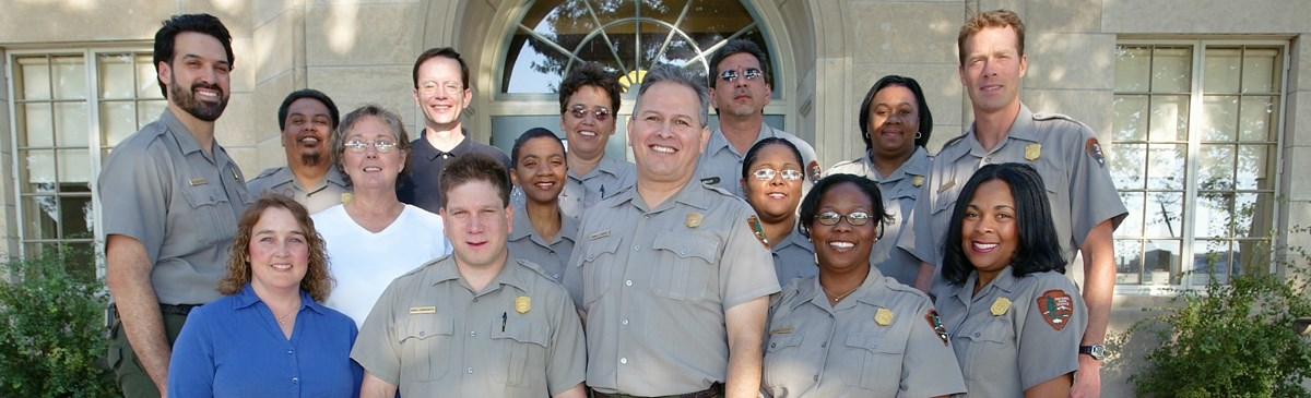 Photograph of the team working at Harpers Ferry National Park. The individuals have differing racial backgrounds (including white, black, and latino). They also differ in gender and age.