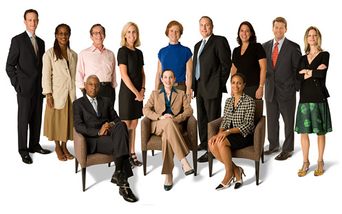 A group of 12 individuals (5 men and 7 women). There are four persons of color in the group.