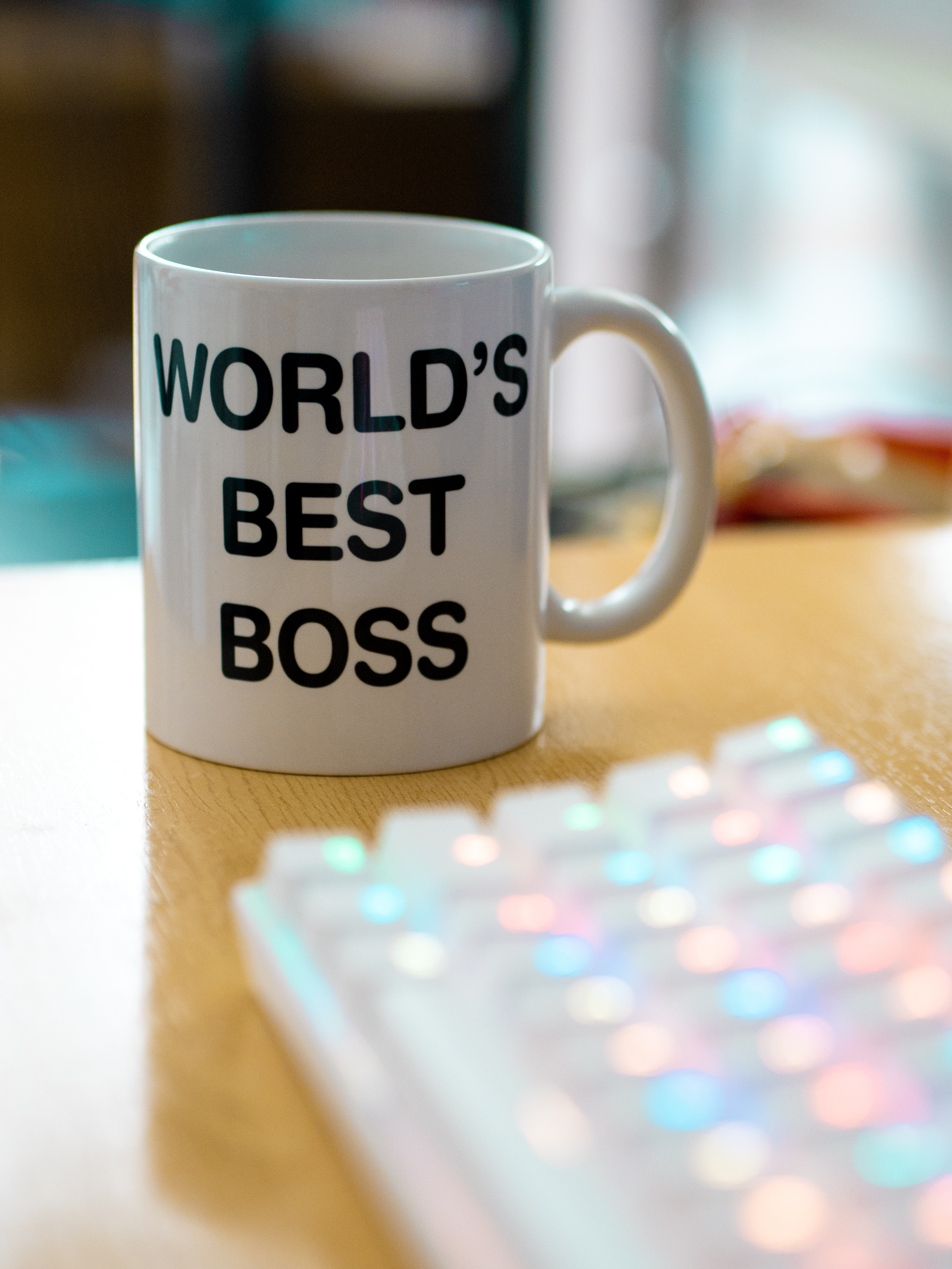 "A mug with the words ""world's best boss"" on it."
