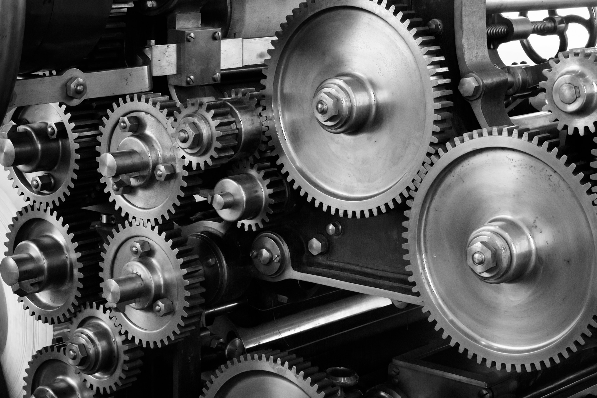 Several cogs in a machine working together in a set pattern.