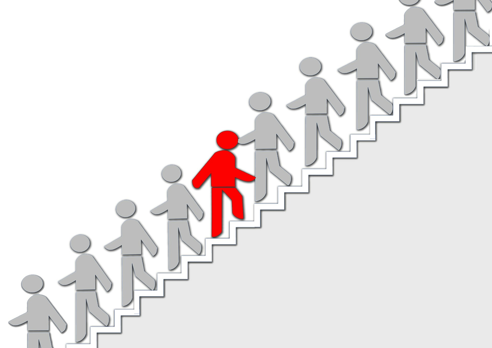 Image of several grey silhouettes walking down a set of stairs. One red individual is walking up the stairs instead.