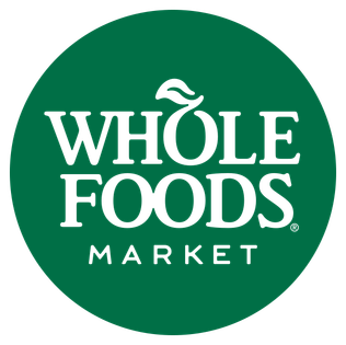 Whole Foods logo, which has the words Whole Foods Market in a green circle. The o in Whole has a leaf.