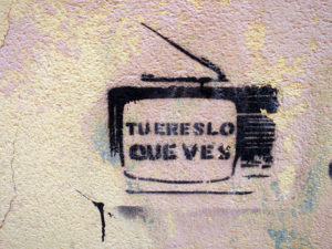 Photo of graffiti which reads: tu eres lo que ves