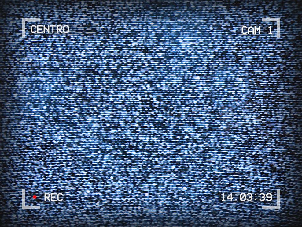 Image of TV static. Text around the outside reads: Centro, Cam 1, 14:03:39, Recording