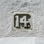 "House number ""14"" carved in stone"