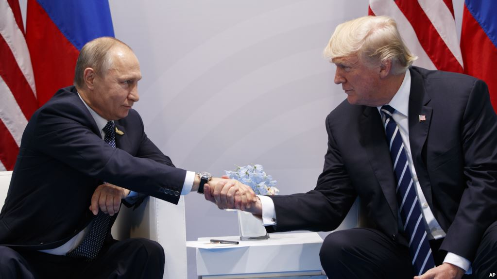 President Donald Trump meets with Russian President Vladimir Putin at the G20 Summit, Friday, July 7, 2017, in Hamburg. (AP Photo/Evan Vucci; at https://www.voanews.com/a/donald-trump-vladimir-putin-russia-meddling-us-election/3933172.html)