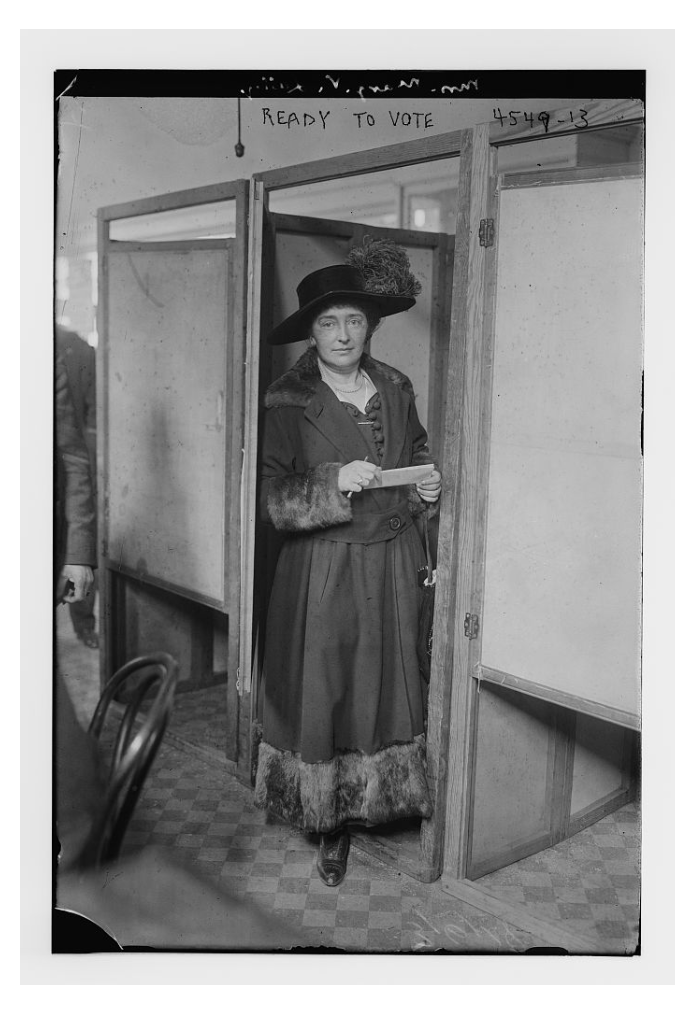 Margaret V. Lally is pictured here at the door of a voting booth during the first election where women could vote. (From the Bain News Service, Library of Congress Collection)