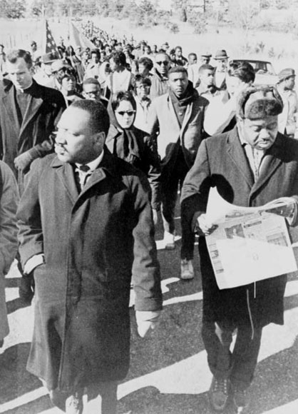 Martin Luther King, Jr. led the civil rights marchers from Selma to Montgomery, Alabama (credit: Rev. Ralph Abernathy walking with Dr. Martin Luther King, Jr., as they lead civil rights marchers out of camp to resume their march to Montgomery, Alabama, 1965. Prints and Photographs Division, Library of Congress. Reproduction Number LC-USZ62-111234. at http://www.americaslibrary.gov /jb/modern/ jb_modern_selma_3_e.html)