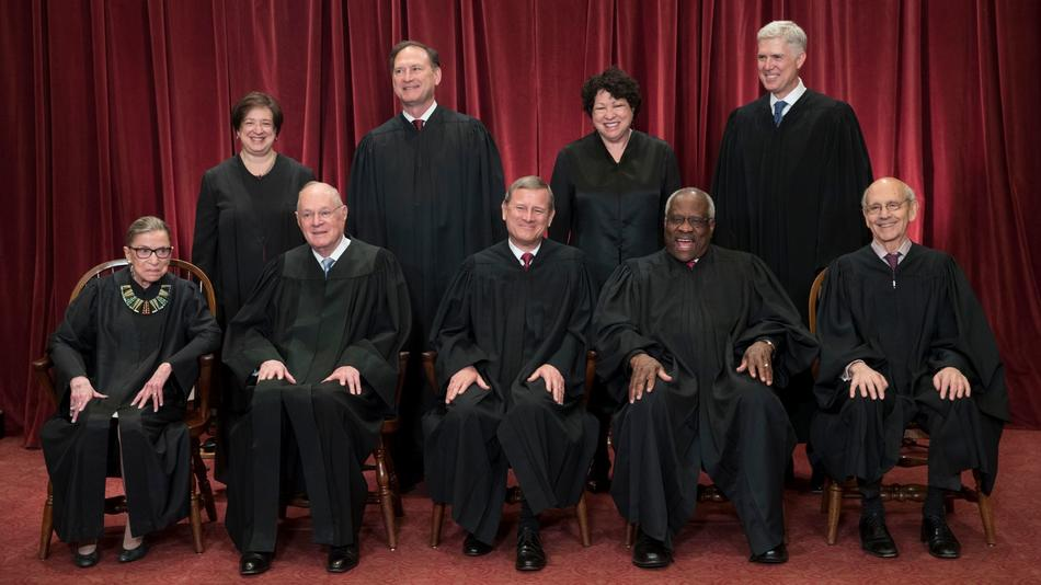 The justices of the U.S. Supreme Court at the Supreme Court Building in Washington on June 1. (J. Scott Applewhite / Associated Press)
