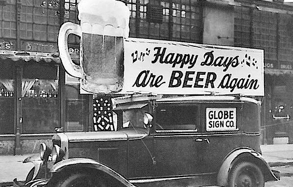 "Photo of car with ""Happy Days are BEER Again"" poster celebrating the 21st Amendment"