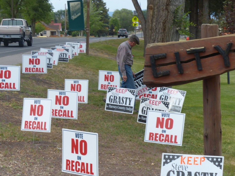 """Photo of yard signs along a busy road """"Vote No on Recall"""""""