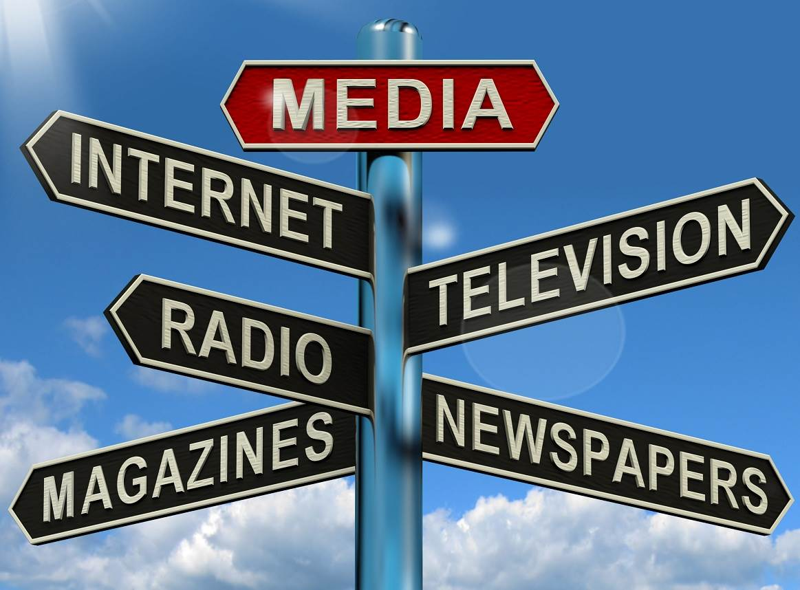 Photo of modified street sign with labels--media, internet, television, radio, magazines, newspapers.