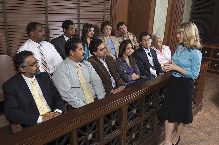Photo of jurors in a jury box inside a courtroom.