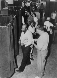 Voters at the voting booths in 1945.