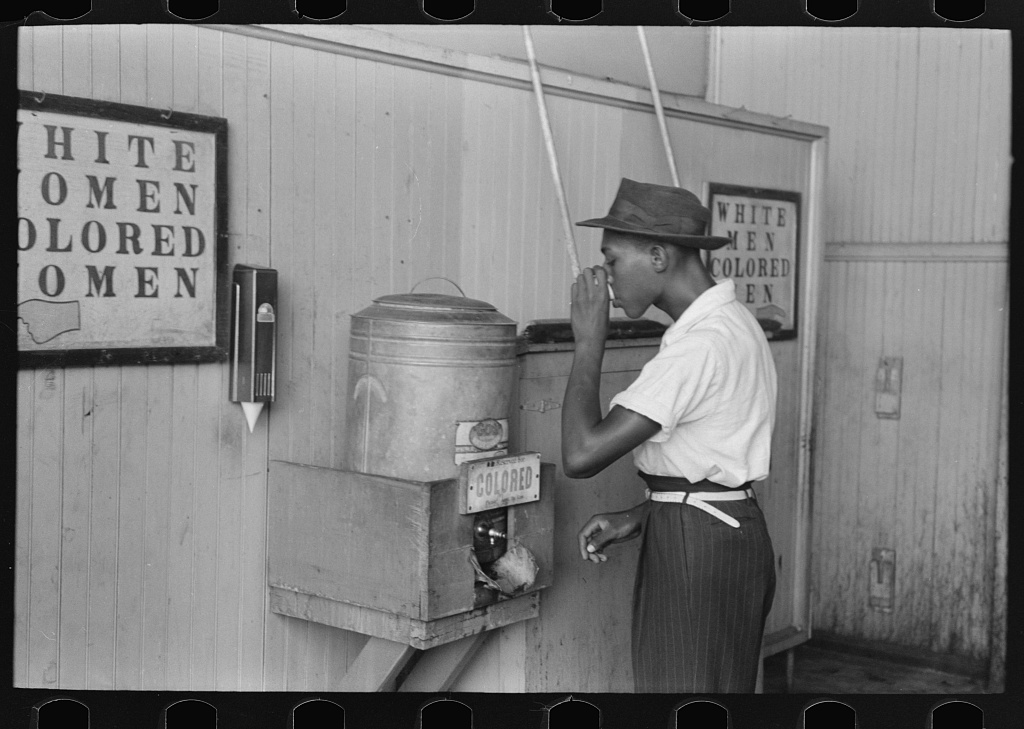 On May 18, 1896, the Supreme Court ruled separate-but-equal facilities constitutional on intrastate railroads. For some fifty years, the Plessy v. Ferguson decision upheld the principle of racial segregation. Across the country, laws mandated separate accommodations on buses and trains, and in hotels, theaters, and schools. (Water cooler in streetcar terminal, Oklahoma City, Oklahoma, contributed by Russell Lee, photographer, 1903-1986, published July 1939, Library of Congress at http://hdl.loc.gov/loc.pnp/pp.fsaowi)