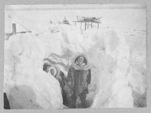 Alaskan Eskimos with their winter home half underground in village of Stebbins Created / Published [between ca. 1900 and ca. 1930]