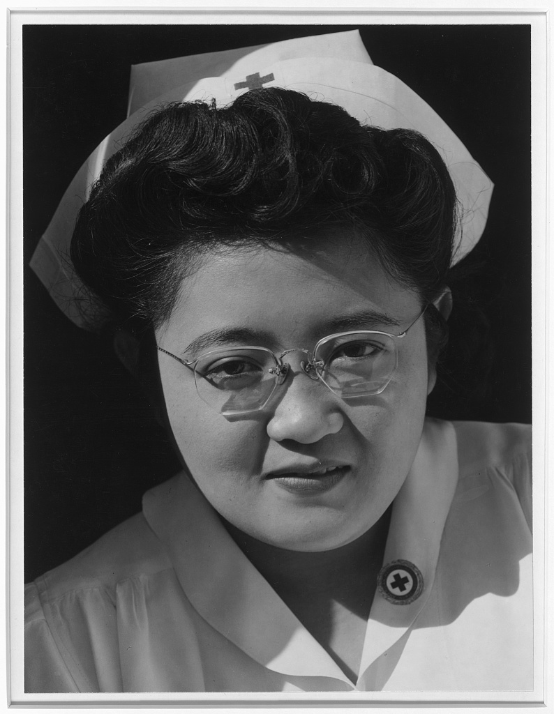 Catherine Natsuko Yamaguchi, Red Cross instructor, Manzanar Relocation Center, Cal. / photograph by Ansel Adams.Adams, Ansel, 1902- Manzanar War Relocation Center photographs; Repository Library of Congress Prints and Photographs Division Washington, D.C. 20540 USA at https://www.loc.gov/item/2001704616.