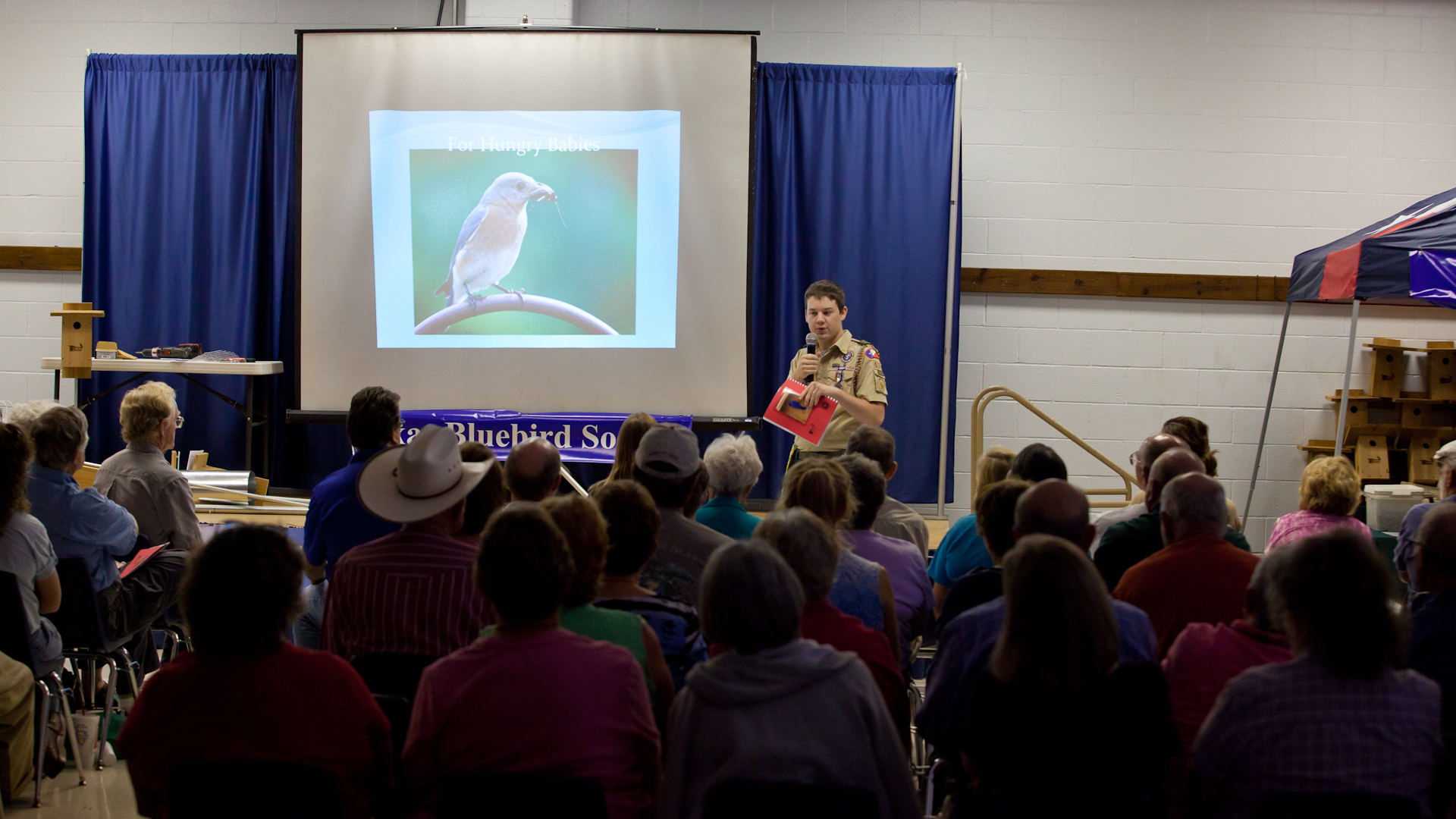 William T. Hornaday Conservation Award Winner and Eagle Scout delivering informative speech about the importance of nest-boxes and promoting the interests of the Texas Bluebird Society at their 10th Annual Meeting and Convention in Glen Rose, Texas on August 20, 2011. TBS is an active interest group advocating on behalf of the protection of Eastern Bluebirds and their habitat.