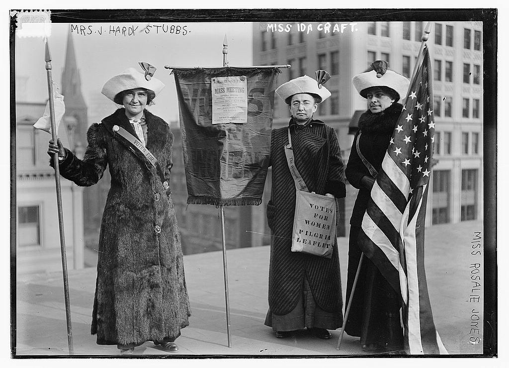 "Political participation in action with Mrs. J. Hardy Stubbs, Miss Ida Craft, and Miss Rosalie Jones preparing to pass out leaflets encouraging citizens to support legislation allowing women to vote.<a class=""footnote"" title=""Summary Photo shows 3 suffragettes with bag ""Votes for Women pilgrim leaflets."" Published [between ca. 1910 and ca. 1915] ; George Grantham Bain Collection (Library of Congress). - General information about the Bain Collection is available at http://hdl.loc.gov/loc.pnp/pp.ggbain; http://hdl.loc.gov/loc.pnp/pp.print Digital Id ggbain 11100 //hdl.loc.gov/loc.pnp/ggbain.11100 Control Number ggb2005011205 Reproduction Number LC-DIG-ggbain-11100 (digital file from original negative) Rights Advisory No known restrictions on publication."" id=""return-footnote-58-1"" href=""#footnote-58-1""><sup class=""footnote"">[1]</sup></a>"