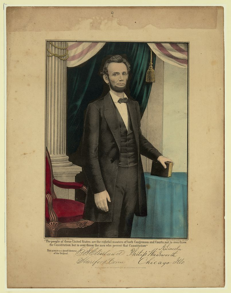 Three-quarter portrait of Abraham Lincoln standing, holding a book, facing right--1809-1865