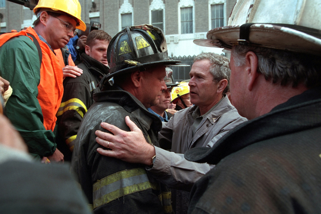 President George W. Bush embraces a firefighter at the site of the World Trade Center Friday, Sept. 14, 2001, during his visit to New York City. Photo by Paul Morse, Courtesy of the George W. Bush Presidential Library