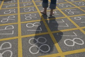 Image of a schoolyard with numbered squares on the asphalt.