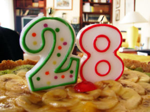 Photo of candles forming the number 28 on a birthday cake