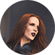 Round photo (like an email avatar) of a woman with long red hair and black lipstick