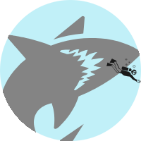 round image of a large shark chasing after a tiny diver