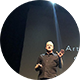 Image of a man onstage talking