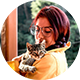Round photo (like an email avatar) of a woman with a cat.