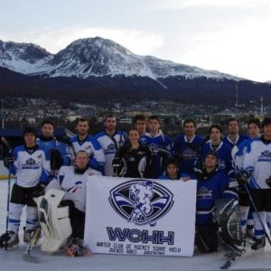 hockey team in front of some mountains