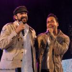 Two men singing into microphones
