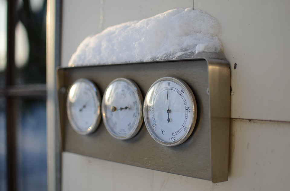 Thermometer covered in snow