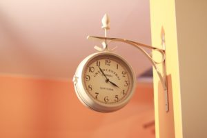 an analog clock reading 3:49