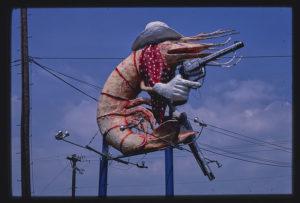 A sign depicting a giant cowboy shrimp.