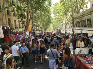 Crowds of shoppers at the Rastro market in Madrid