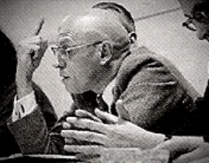 a cropped close up of Michel Foucault in a panel presentation