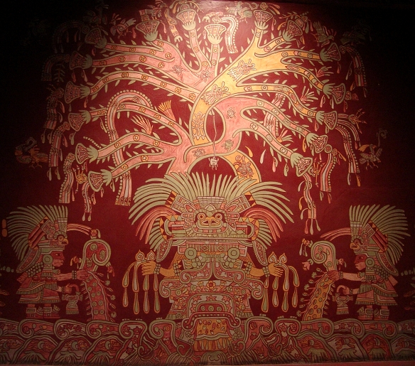 intricate red mural depicting figures under a tree