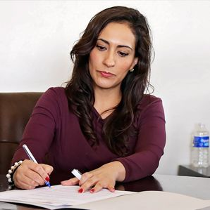 Woman writing on a piece of paper.