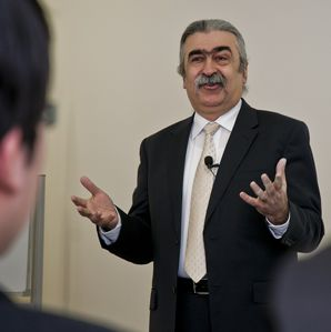 Man in suit speaking in front of audience
