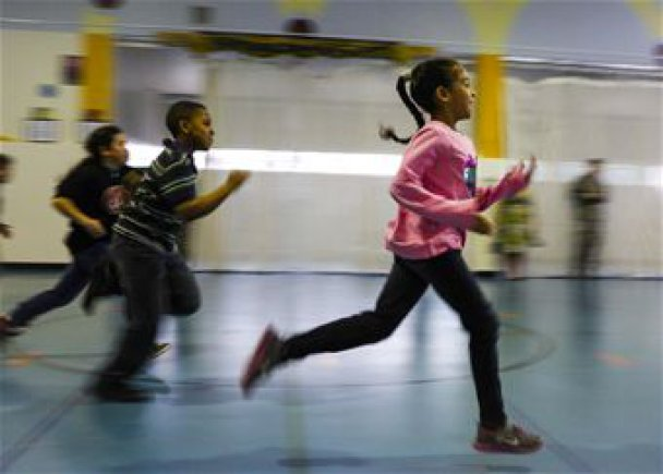 Children running in a gym.