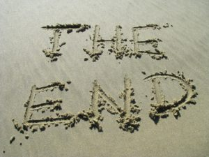 "The words ""the end"" written in sand."