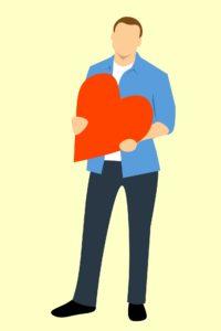 Cartoon man holding a heart.