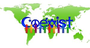"""A map of the world with the word """"coexist"""" overlayed."""